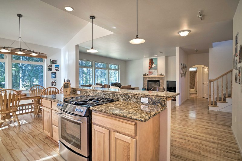 The home boasts 3 bedrooms, 2 baths, a 3-car garage, full kitchen & more!