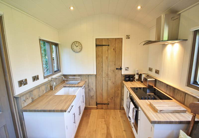 Kitchen area with butler sink, oven, small fridge, kettle and toaster.Mini hamper to welcome you.