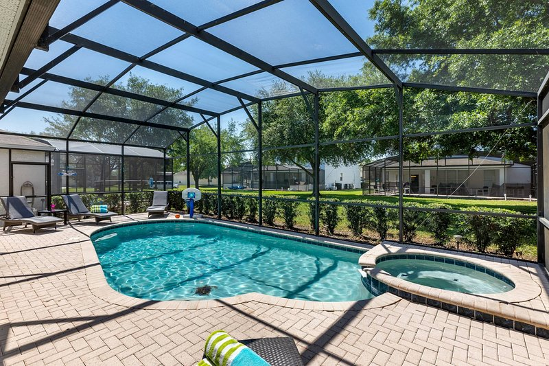 Private screened in, salt water pool and spa with free pool heat and an over-sized pool deck