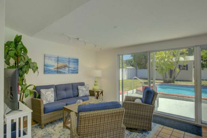 TV room with great views.... Sliders open out to the pool for easy access.