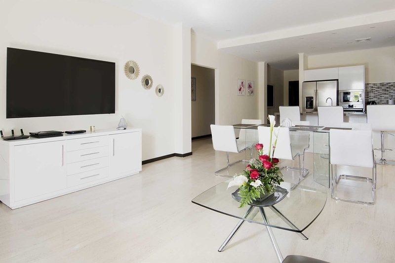 Welcome to your spacious living area with a large Smart TV