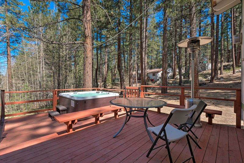 Relax on the back deck and gaze out at the towering pine trees.