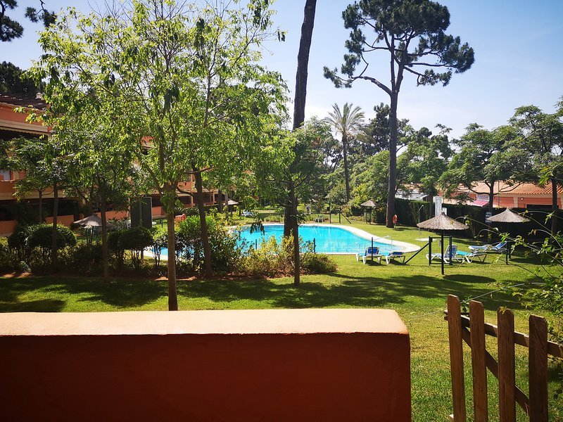 Direct gate access from our terrace to the pool and gardens at Pino Golf Elviria
