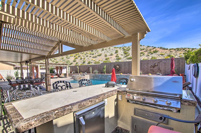 The backyard oasis offer a private pool, hot tub and BBQ area!