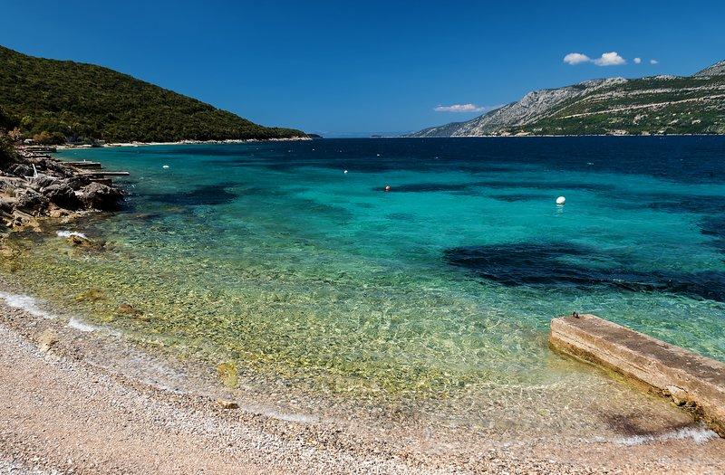 Clear blue sea and beach near villa