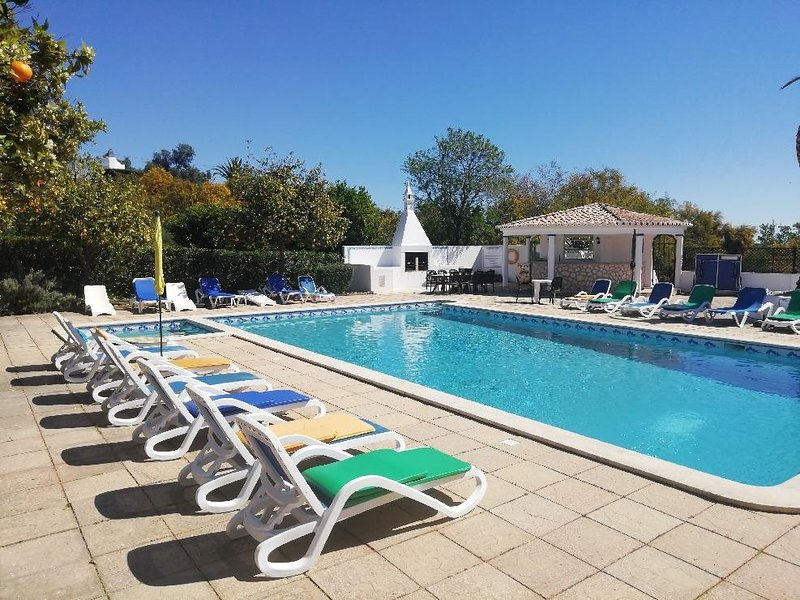 The pool and its deckchairs