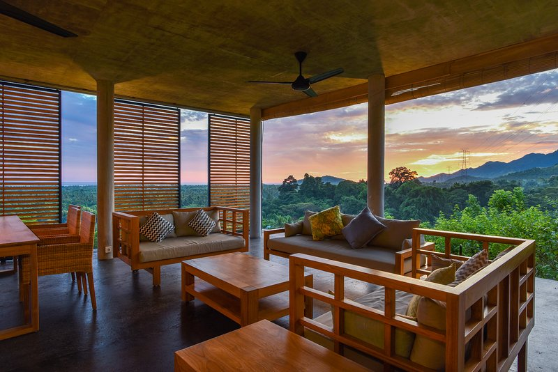 Lounge area with sliding doors. Open them up and you are in the middle of nature.