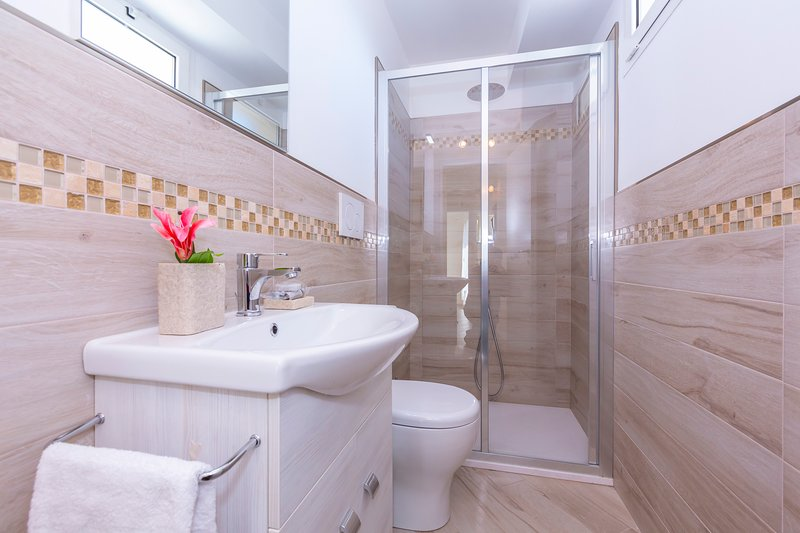 Bathroom with shower, WC and bidet