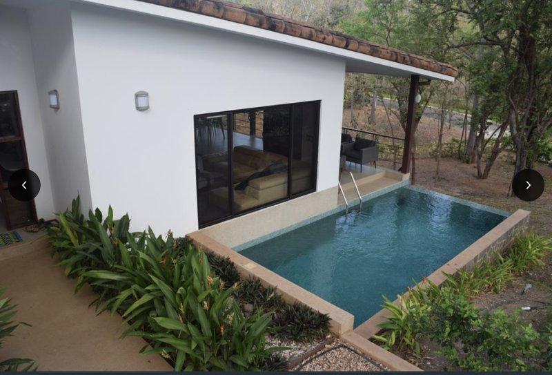 family room, pool, patio view