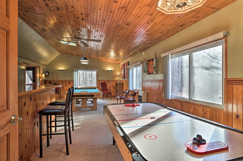 The 5-bed, 2.5-bath vacation rental boasts a deck, game room, & beach access.