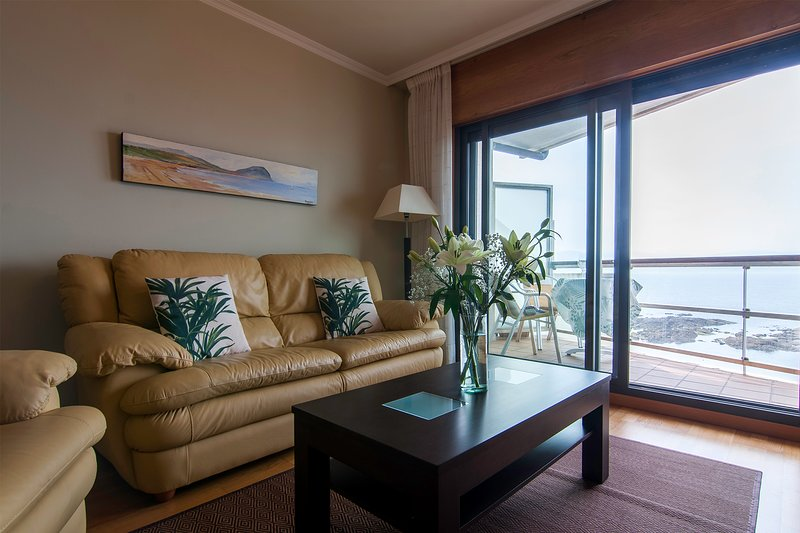 Living room with balcony overlooking the marina