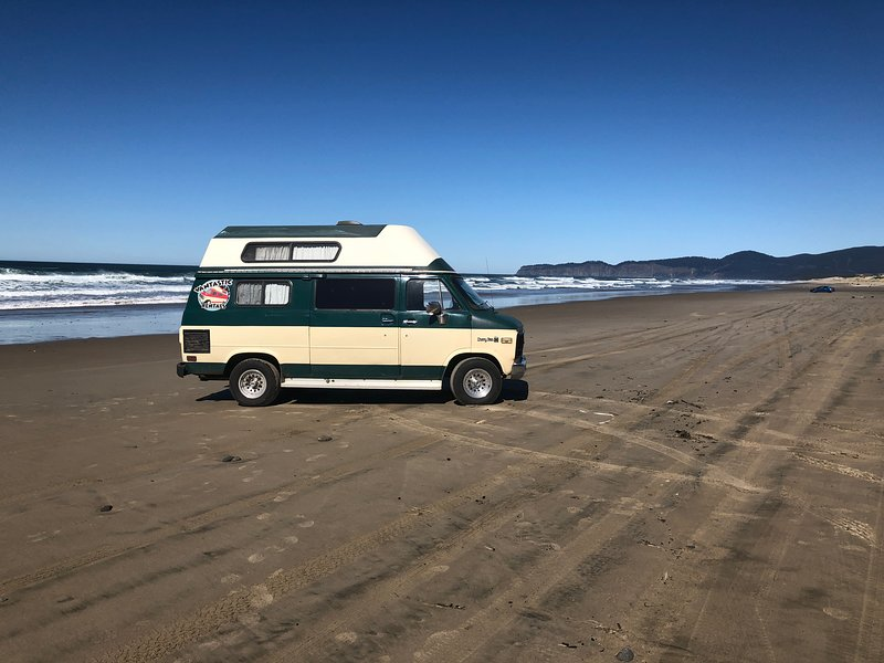 Our Van Gogh van on the beach in Oregon.