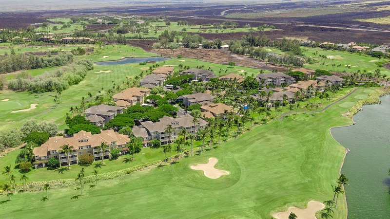 Aerial view of condominiums and golf course