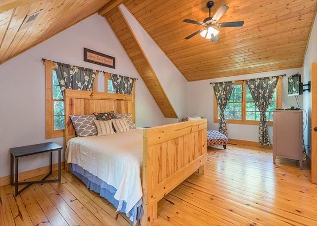 Upstairs master bedroom with TV.