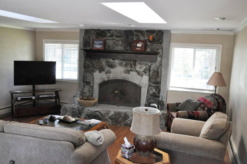 Spacious Main living room with TV and large gas fireplace