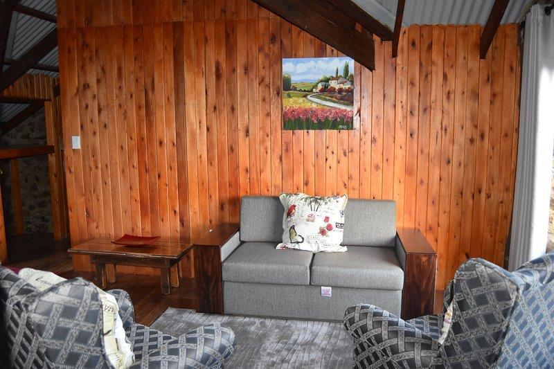 Área de estar del loft de Kiepersol