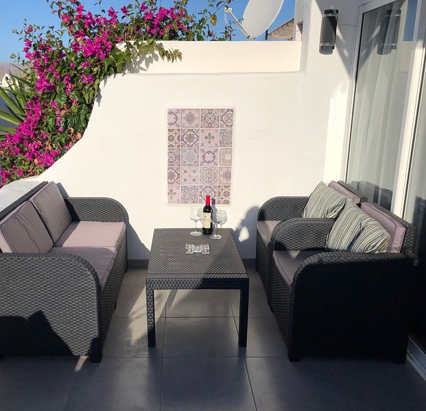 Sunny terrace with retractable canopy