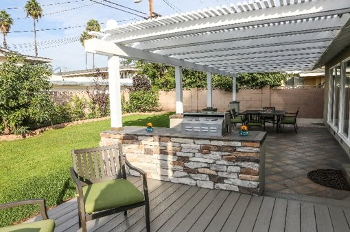 Outdoor patio and gas grill view 2