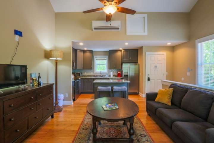 This second floor carriage house features high ceilings, great natural light and plenty of space to relax.