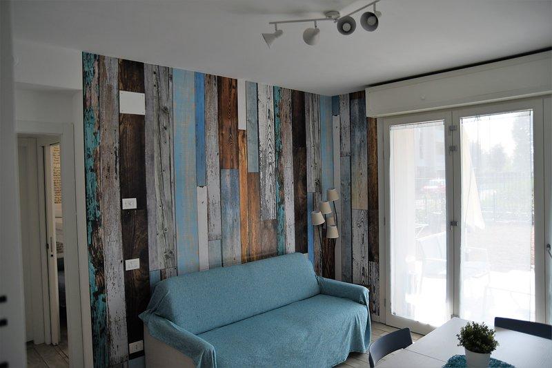 Casa Azzurra incantevole bilocale con giardino, vakantiewoning in Carugate