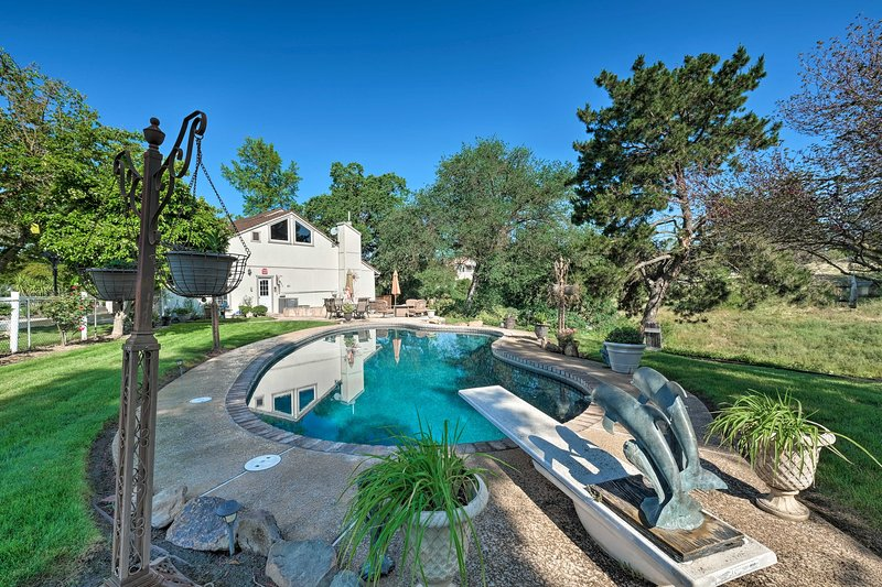 This 4-bed, 3-bath home boasts a beautiful backyard oasis with a built-in pool.