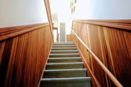 Entry stairs lined with restored redwood