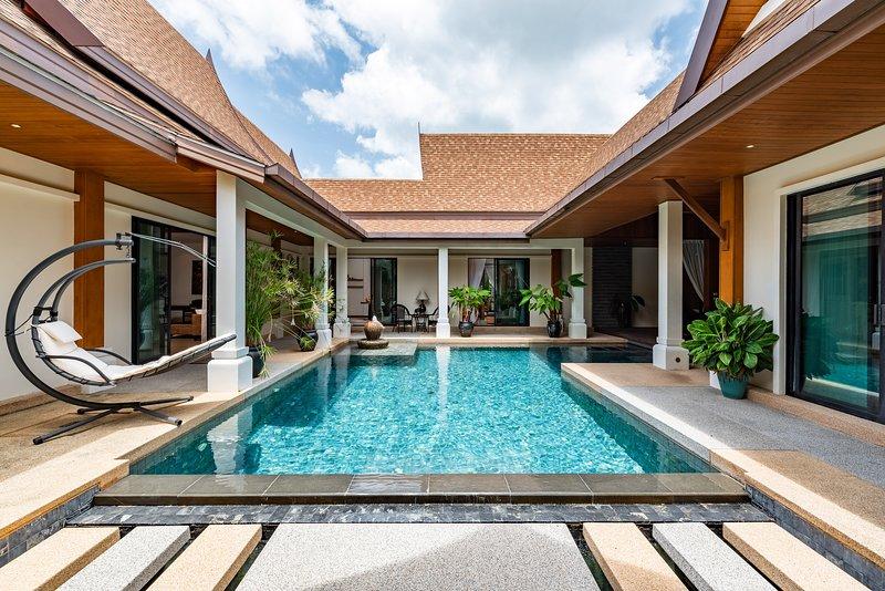 Champange Pool Villa, location de vacances à Nai Harn