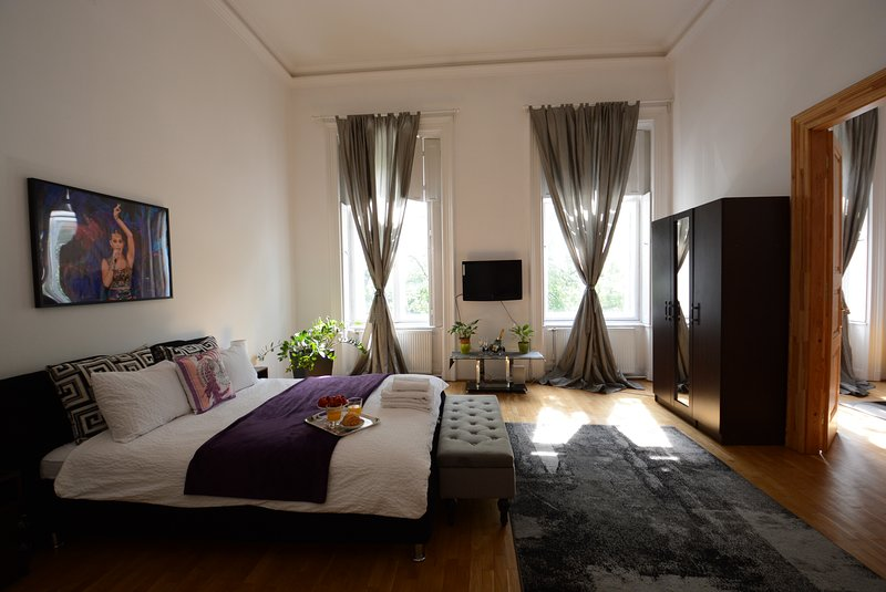 Certificate of Excellence bedroom with queen-size bed and a very comfortable sofa bed