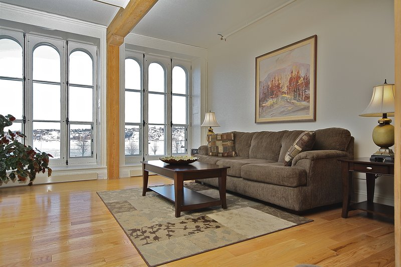 The living room accentuated by 8 foot windows overlooking the St.Lawrence River.