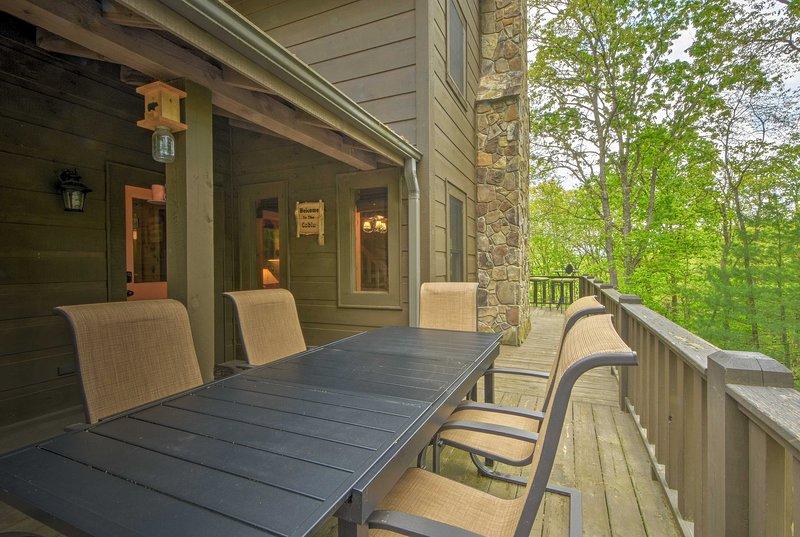 Enjoy serene forest views from the wraparound porch.