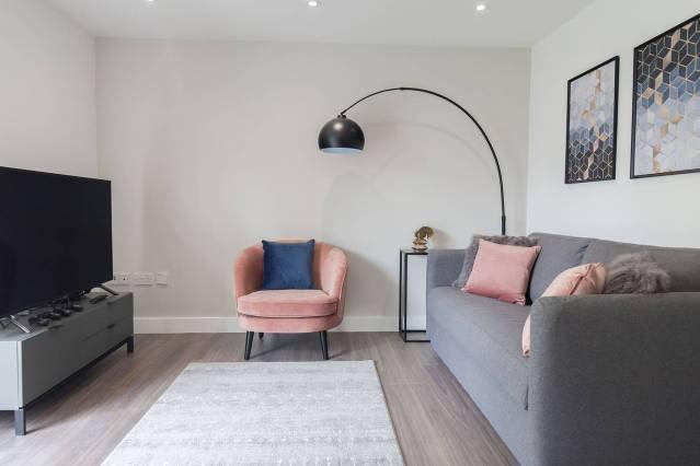 Soggiorno open space con divano letto