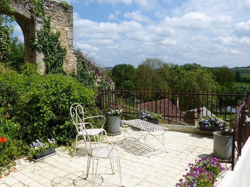 The terrace overlooking the Loir and its valley. Fortified gate next