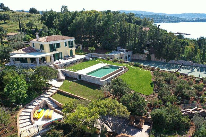 Villa Aria - Luxury Beachfront Villa with Swimming pool and Tennis Court, vacation rental in Porto Heli