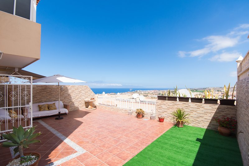 Large rear terrace with sea and mountain views