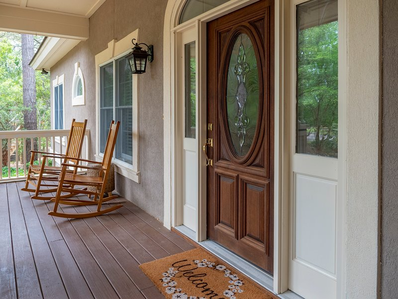 Beautiful, private setting with welcoming porch entrance