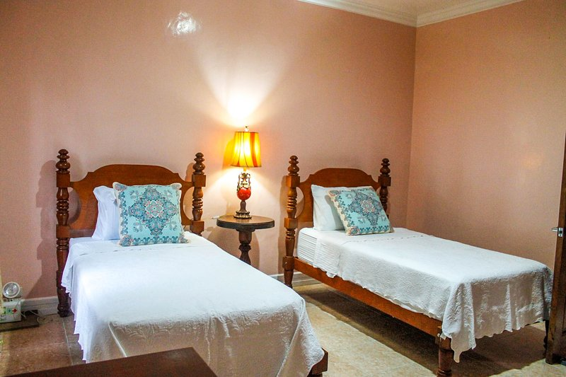 The hotel  is set between a scenic forest view and the vast calm blue sea., holiday rental in Leyte Island