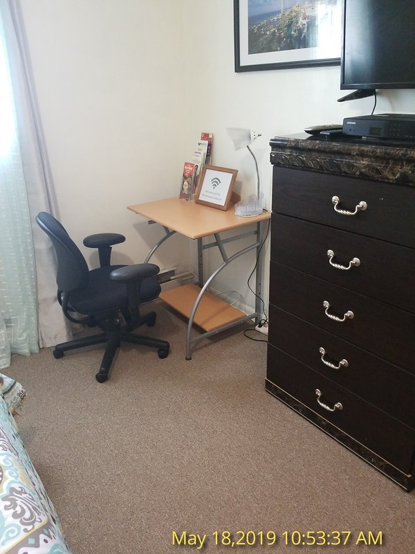 Computer desk in one of the rooms in 3bedroom apt