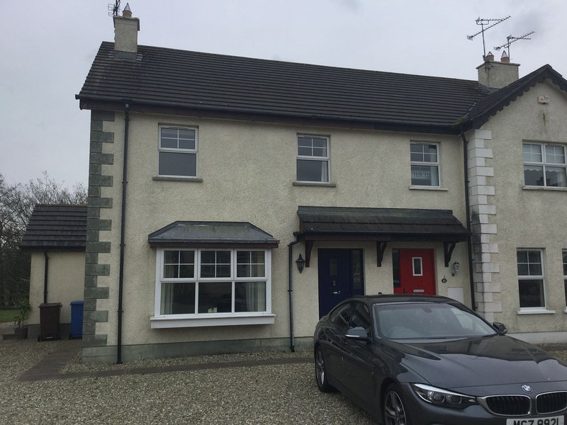 Front of property with spacious private parking for 2+ cars