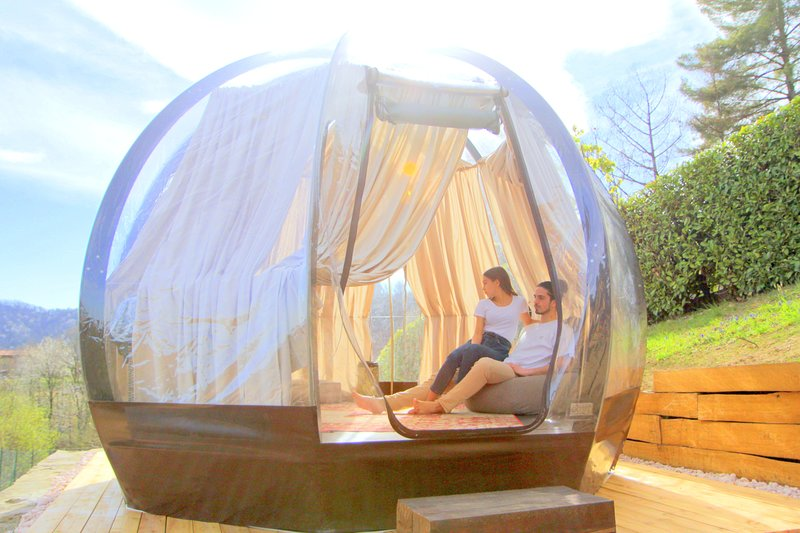 The transparent sphere with heated floor and futon bed