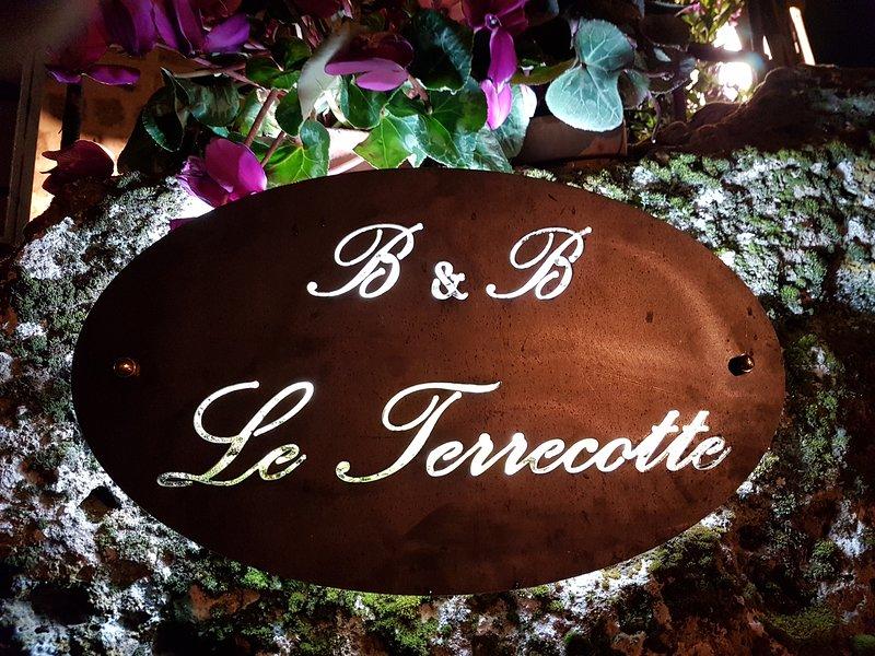 Backlit antiqued iron plaque