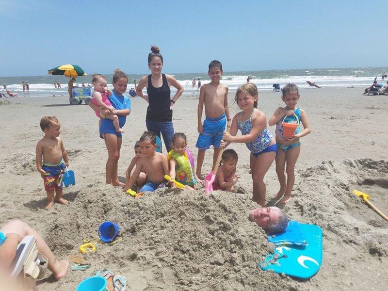 A fun day at the beach burying grandpa!