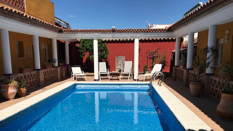 Swim or sunbathe in complete privacy in our roman style swimming pool