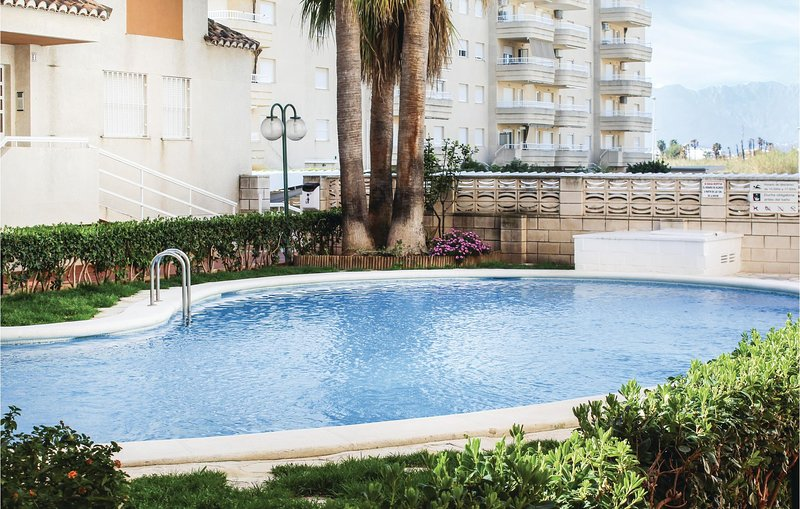 Amazing apartment in Daimús with Outdoor swimming pool, Outdoor swimming pool a, location de vacances à Bellreguard