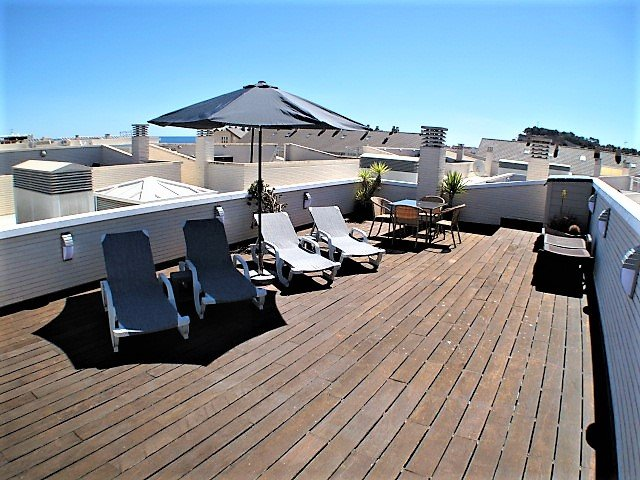The large private roof top terrace is ideal for sun bathing with views of the sea and the mountains.