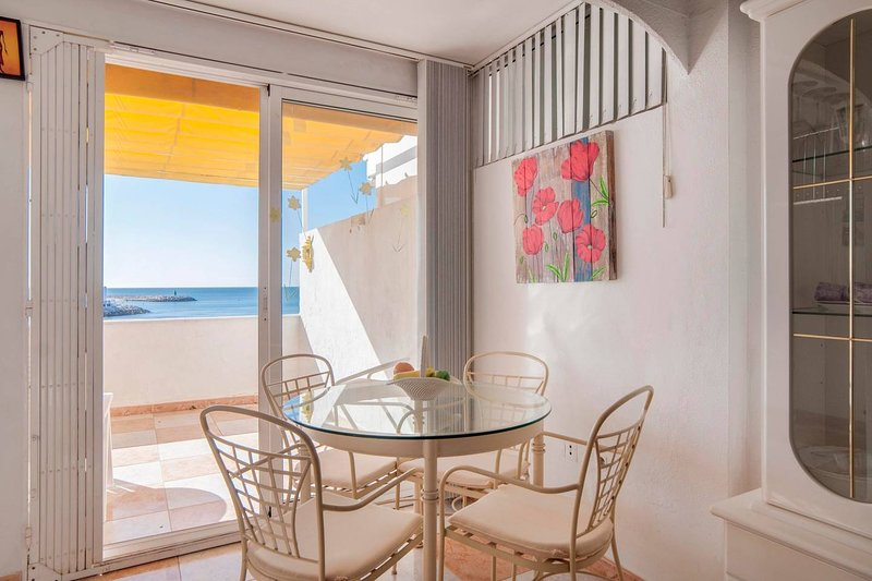 Ole Playa Beach Front Apartment - 008, vacation rental in Arroyo de la Miel