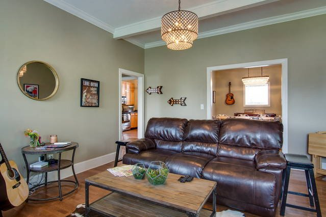 Super comfy and spacious living room with reclining sofa and internet-connected TV