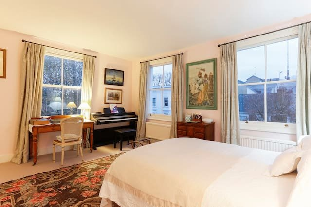 Spacious master bedroom with double bed
