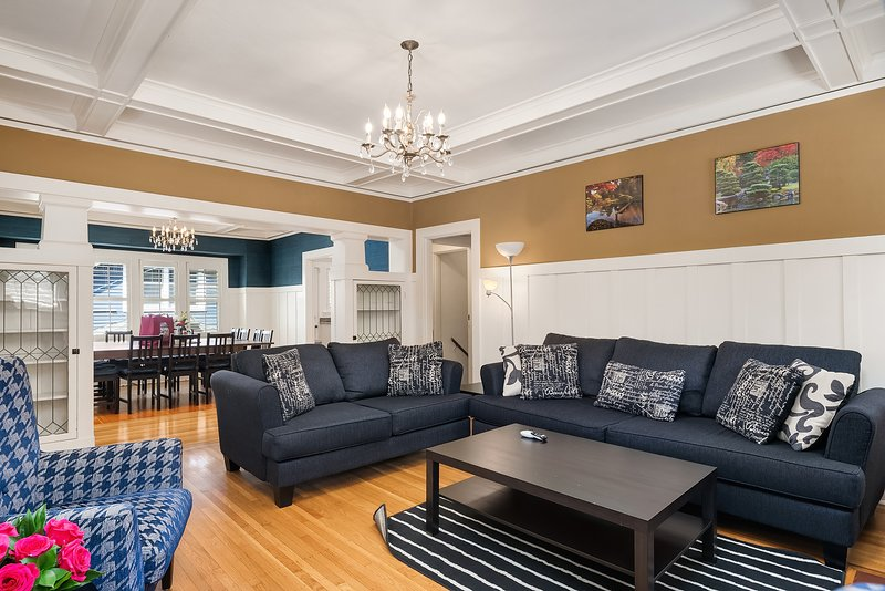 The spacious living area features a comfortable queen size sleeper sofa, love seat, 50' tv, DVD, and a decorative fireplace.