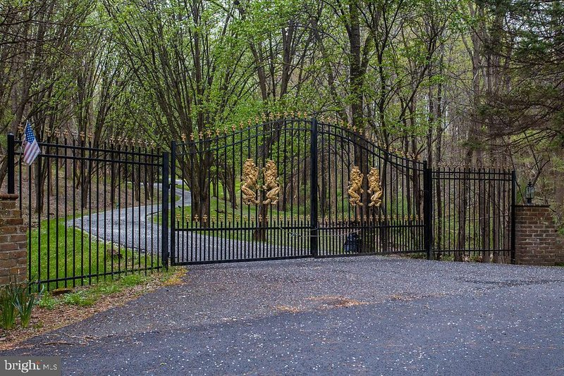 The paparazzi are held at bay by the gates to the Estate.