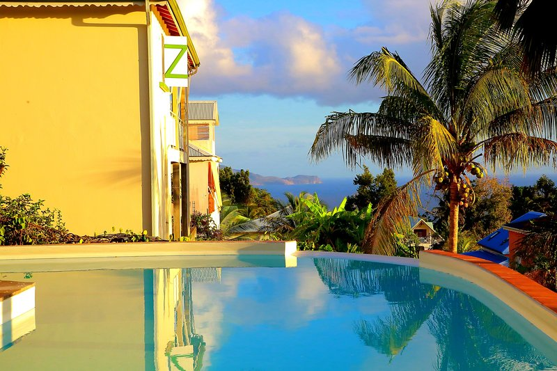 Beautiful roof top with pool and sea view in the background ***, holiday rental in Vieux-Fort